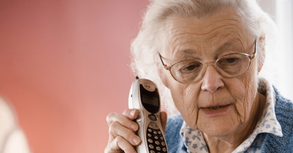 Senior on Cordless Phone with ambiguous look